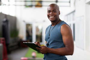 34093482 - handsome african american male trainer with clipboard