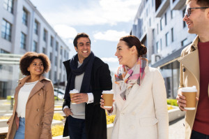 group of people or friends with coffee in city